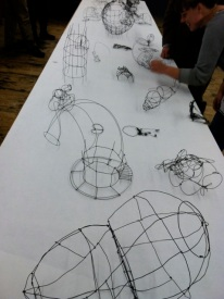small wire sculptures created by attendees during the conference